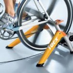 Triathletes and an indoor bicycle training stand