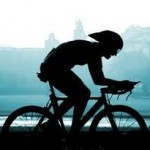 silouette of a triathlete on a triathlon bike